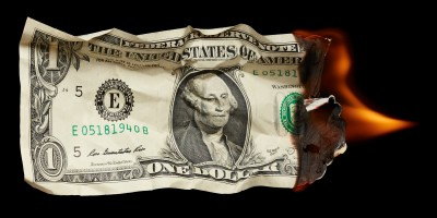 burning dollar | Retirement Withdrawal Strategies