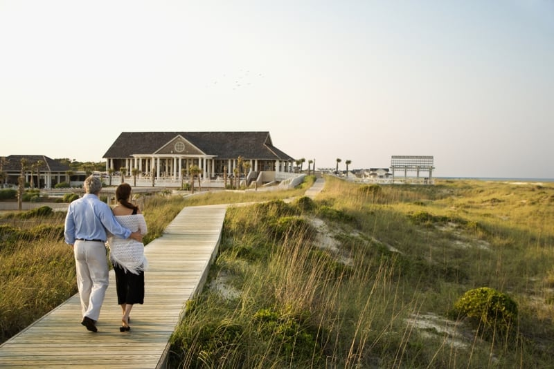 couple on boardwalk | wealth building after 50