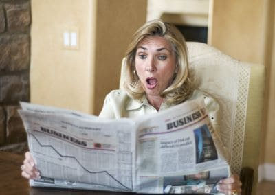 woman reading bad financial news